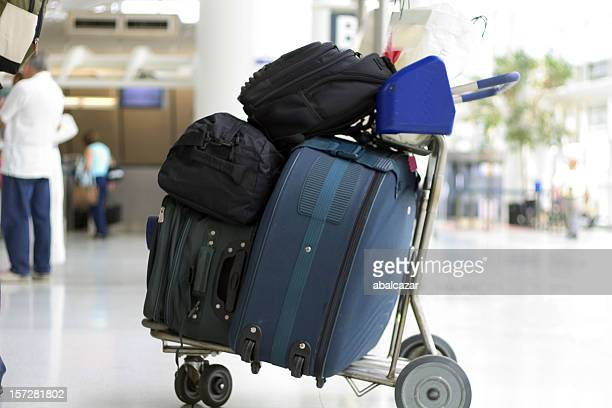 Baggage cart with bags packed on top