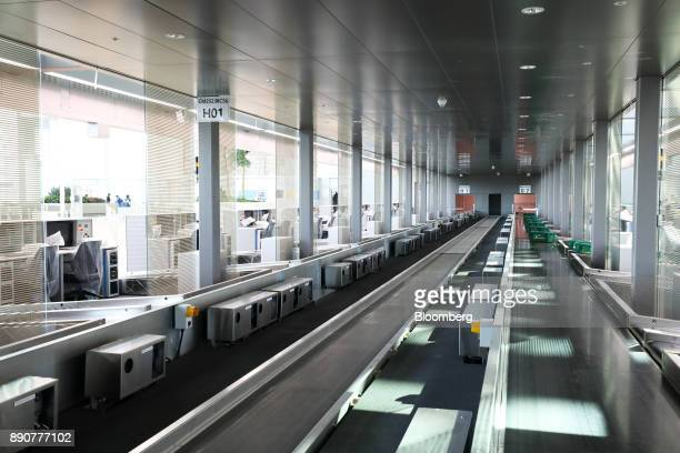 A baggage conveyor runs through the nearly completed terminal 2 building during a media preview at Incheon International Airport in Incheon South...