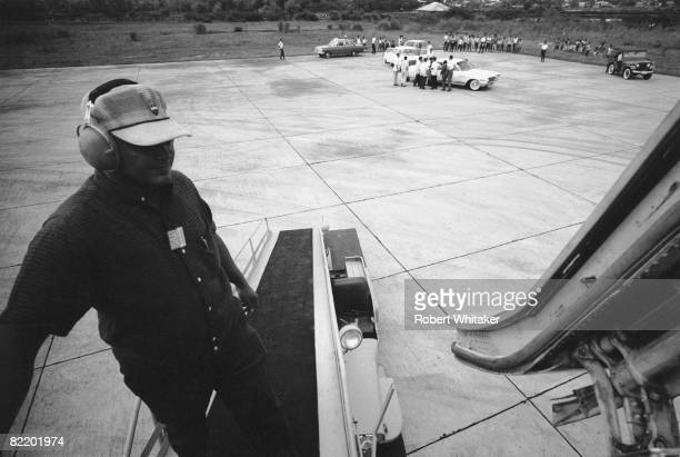 A baggage handler at Manila International Airport unloads a Japan Airlines plane bringing the Beatles on their final world tour 3rd July 1966 The...