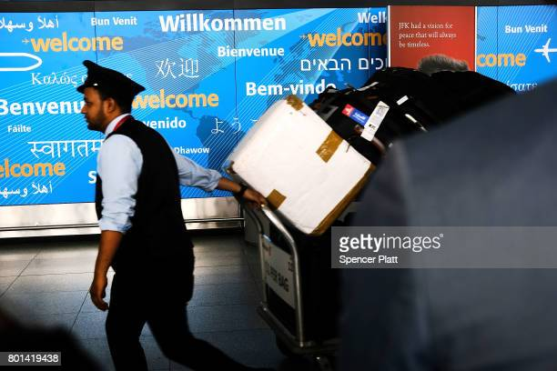A baggage handler walks through international arrivals at terminal four at John F Kennedy airport following an announcment by the Supreme Court that...