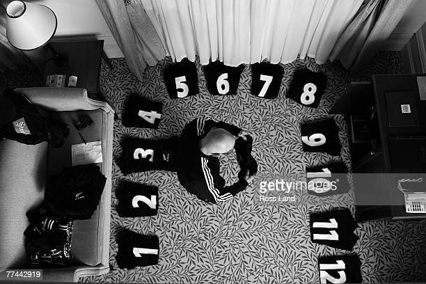 Baggage manager Erol Collins lays out the test jerseys at the team hotel on Saturday prior to the 2007 Tri Nations match between the New Zealand All...