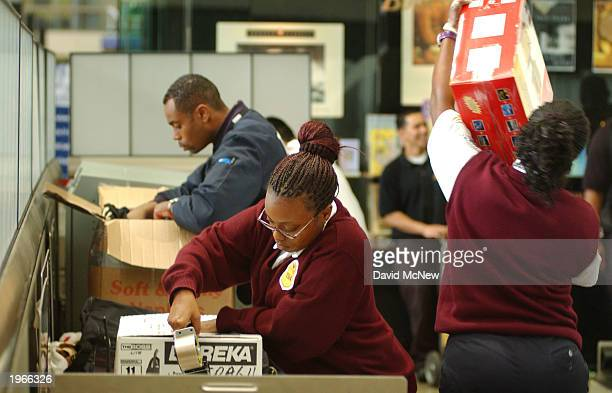 Baggage screeners search travelers' packages at Los Angeles International Airport May 1 2003 in Los Angeles California Tom Blank assistant...