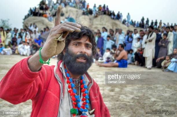 a bagger boy is in the ground of sindhi pakistani traditional game of malh, - sindhi culture stock photos and pictures