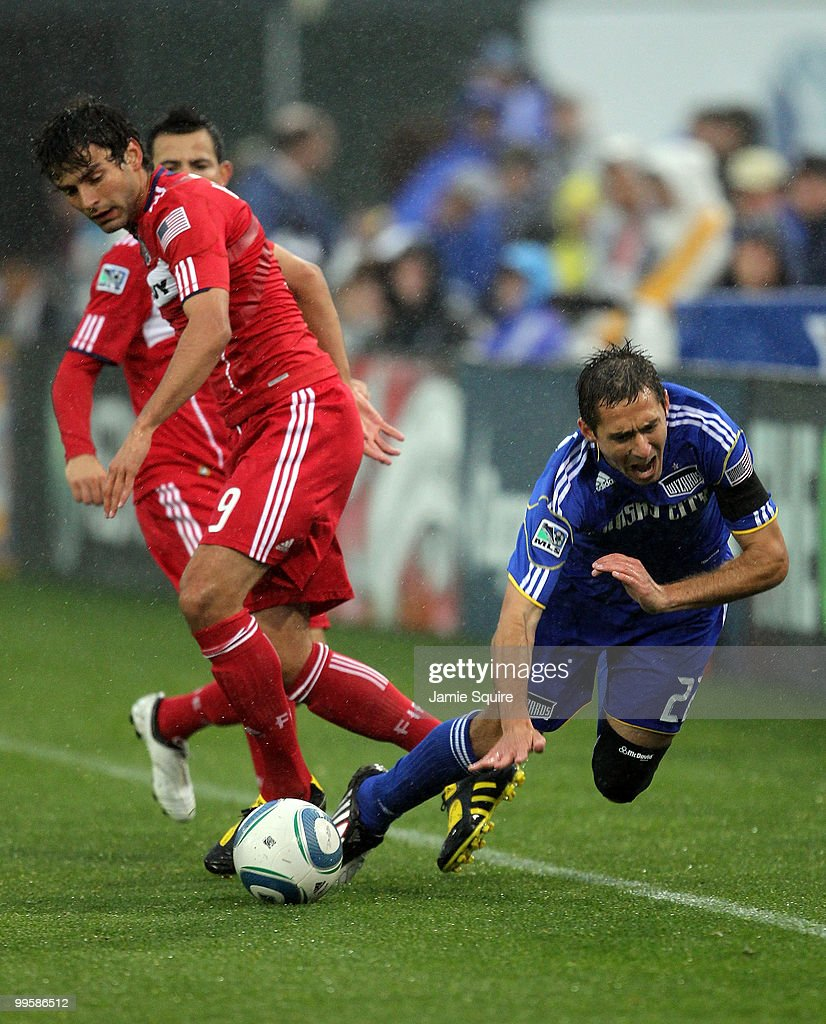 Baggio Husidic #9 of the Chicago Fire battles Davy Arnaud #22 of the Kansas City Wizards for the ball during the game on May 15, 2010 at Community America Park in Kansas City, Kansas.