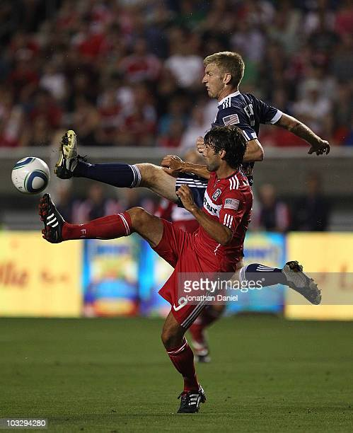 Baggio Husidic of the Chicago Fire battles for the ball with Tim Ream of the New York Red Bulls in an MLS match on August 8, 2010 at Toyota Park in...