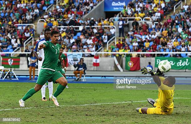 Baghdad Bounedjah of Algeria scores their second goal past Luis Lopez of Honduras during the Men's Group D first round match between Honduras and...