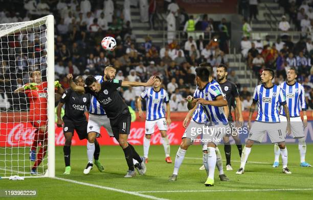 Baghdad Bounedjah of AlSadd Sports Club jumps for the ball with Nicolas Sanchez of CF Monterrey during the FIFA Club World Cup 2nd round match...