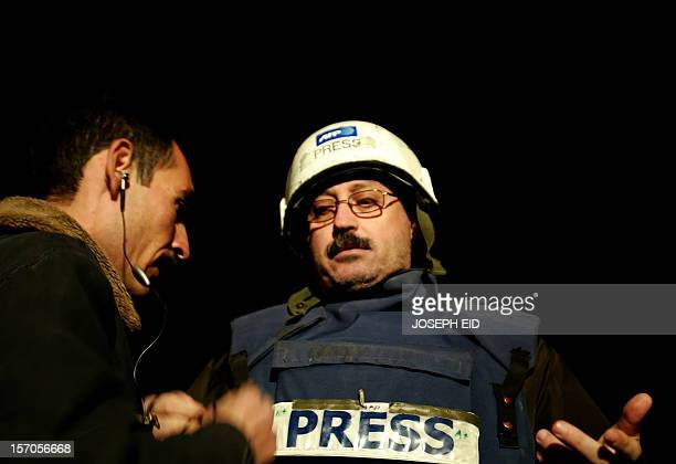 AFP Baghdad deputy bureau chief Assaad Abboud prepares to conduct a live interview with France 24 television from the Iraqi capital 06 December 2006...