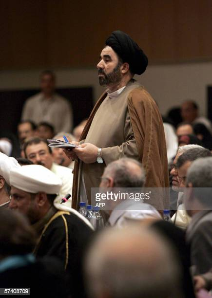 A member of the Iraqi parliament speaks during a parliament session held under tight security in Baghdad's heavily fortified Green Zone 22 April 2006...