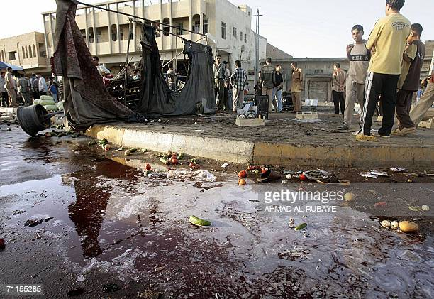 A pool of blood is seen at the site where a car bomb exploded in a market place in Baghdad's Kazemiya district 08 June 2006 Seven people were killed...