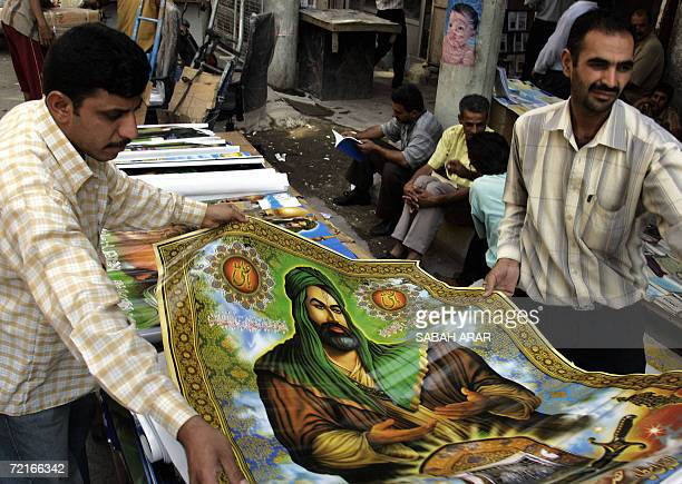 A Shiite Iraqi displays a poster of Shiite Imam Ali at his shop in Baghdad 14 October 2006 as Shiites head from all over the country to the holy city...