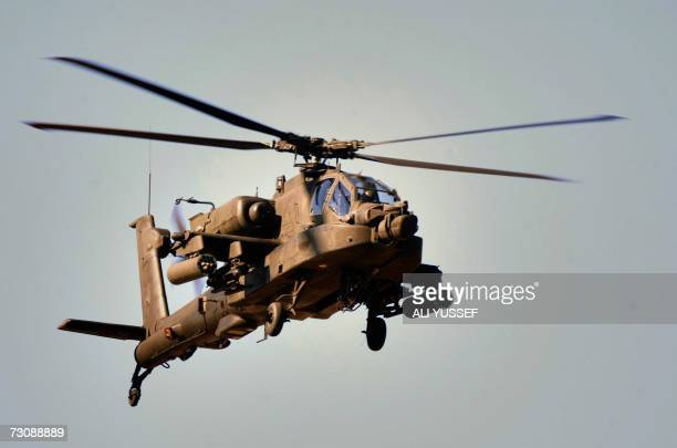 A US Apache helicopter hovers over Baghdad's restive Haifa street district 24 January 2007 A raging battle broke out early in the day between...