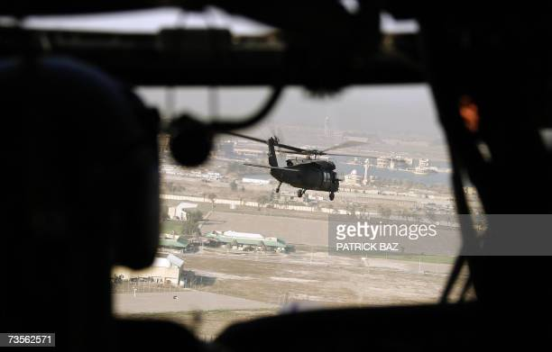 Army Blackhawk helicopter flies over former Iraqi president Saddam Hussein's al-Salam palace, transformed into a US base dubbed Camp Victory, in...
