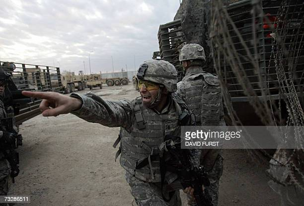 Soldier from Bravo Company 5-20 Infantry Regiment barks an order as his squad engages in a sustained gunfight with unidentified gunmen after their...