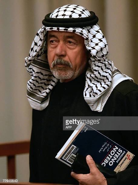 Ali Hassan alMajid first cousin of executed president Saddam Hussein and also known as 'Chemical Ali' listens to prosecution evidence during the...