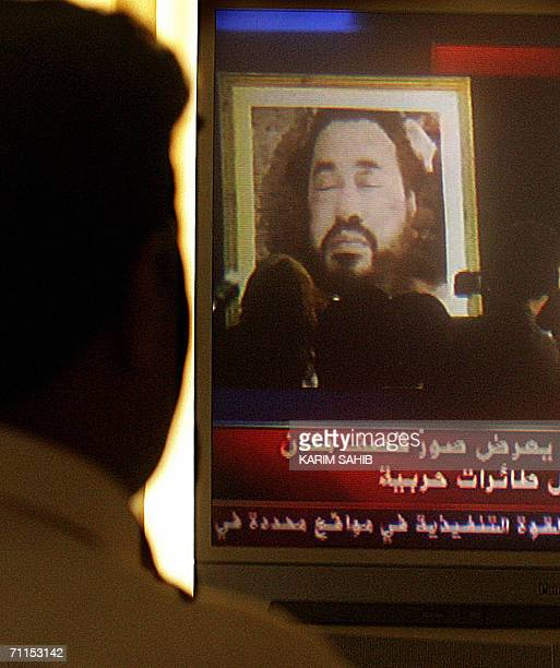 An Iraqi looks at nn image made avilable by the US Army 08 June 2006 of slain AlQaeda chief in Iraq Abu Musab alZarqawi who was killed in a joint...