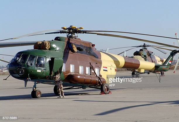 An Iraqi soldier checks an Iraqi helicopter that belongs to the new Iraqi Air Force prior a standup of the new alMuthana Air Base and the 23rd...