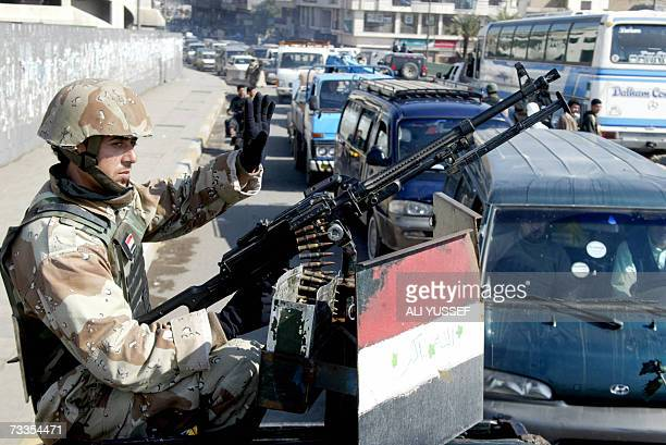 An Iraqi soldier gestures as he monitors an area at a checkpoint in central Baghdad 17 February 2007 Attacks and killings in the war torn capital...