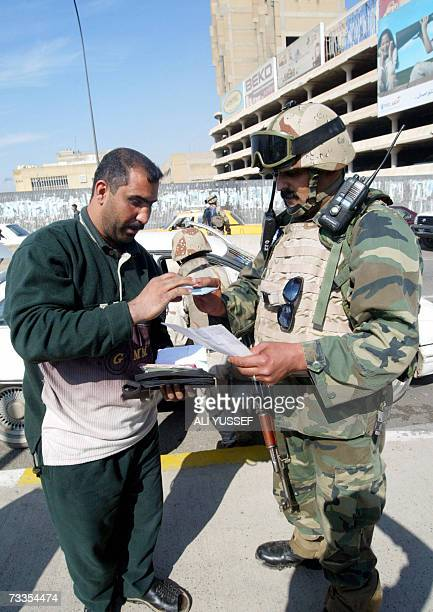 An Iraqi soldier inspects the papers of a man at a checkpoint in central Baghdad 17 February 2007 Attacks and killings in the war torn capital have...