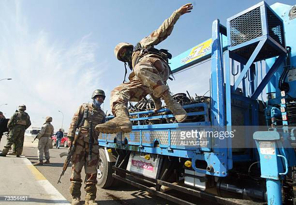An Iraqi soldier jumps from the back of a truck after searching it at a checkpoint in central Baghdad 17 February 2007 Attacks and killings in the...