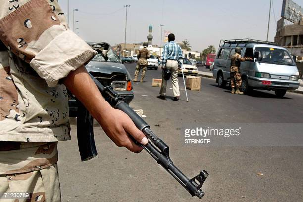 An Iraqi soldier secures a checkpoint in a street in Baghdad 18 June 2006 A wave of bombings and kidnapping have disrupted a massive security...