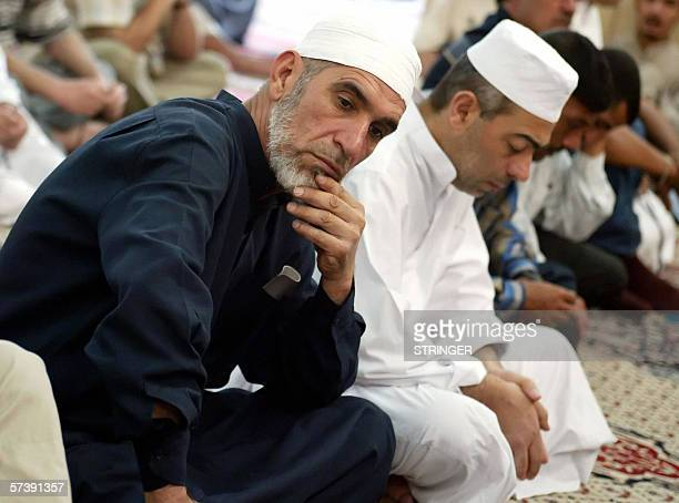 An Iraqi Sunni man looks on as he listens to the Friday sermon at the Abu Hanifa mosque in Baghdad 21 April 2006 Embattled Iraqi Prime Minister...