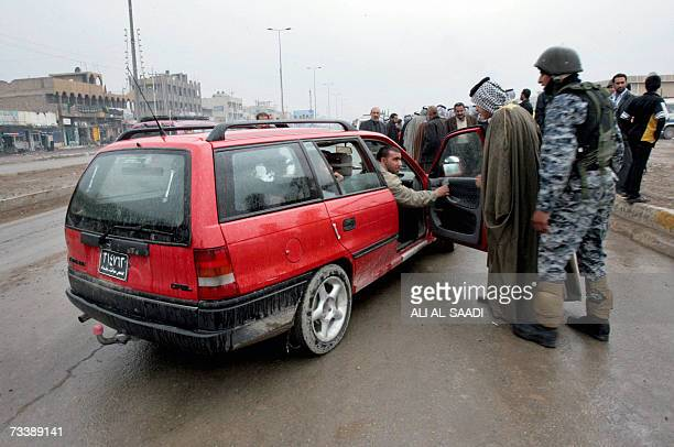 An Iraqi tribal leader stops a car to be searched at an Iraqi police commando checkpoint in Baghdad's impoverished district of Sadr City 22 February...