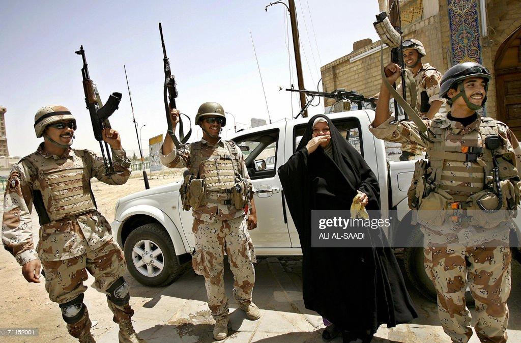 An Iraqi woman shares Iraqi soldiers the : News Photo