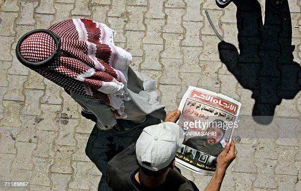 An Iraqi youth looks at the image of slain alQaeda leader in Iraq Abu Musab alZarqawi published 13 June 2006 in an Iraqi newspaper in Baghdad AlQaeda...