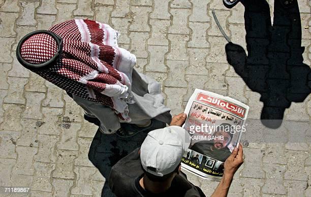 An Iraqi youth looks at the image of slain al-Qaeda leader in Iraq Abu Musab al-Zarqawi published 13 June 2006 in an Iraqi newspaper in Baghdad....