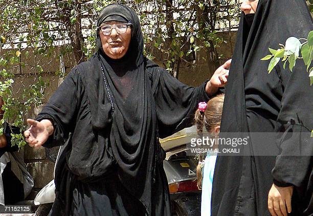 An Iraqo woman mourns the death of a relative outside a local hospital in Baghdad 08 June 2006 Eight Iraqi were killed and 36 were wounded in two...