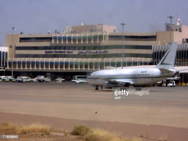 An unidentified plane sits on the runway of the Baghdad international airport 06 July 2006 Formerly known as Saddam International Airport the...