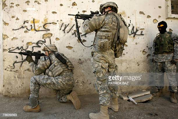 CORRECTING CAVALRY REGIMENT US soldiers with the 9th Cavalry Regiment scan rooftops looking for a sniper in Baghdad's Haifa street while their masked...