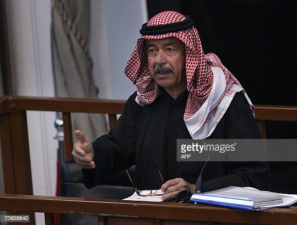 Defendant Ali Hassan alMajid known as 'Chemical Ali' gestures as he addresses the court during his trial in Baghdad 28 November 2006 The trial of...