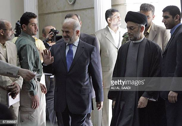 Embattled Iraqi Prime Minister Ibrahim Jaafari and Shiite politician Abdel Aziz alHakim arrive for a press conference in Baghdad 22 April 2006 Shiite...