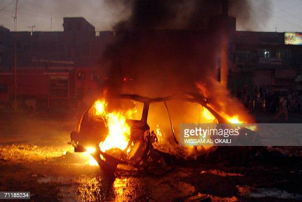 Flames engulf a car that exploded in Baghdad's poor Sadr City neighborhood 12 June 2006 Two separate pairs of deadly car bombs exploded within...
