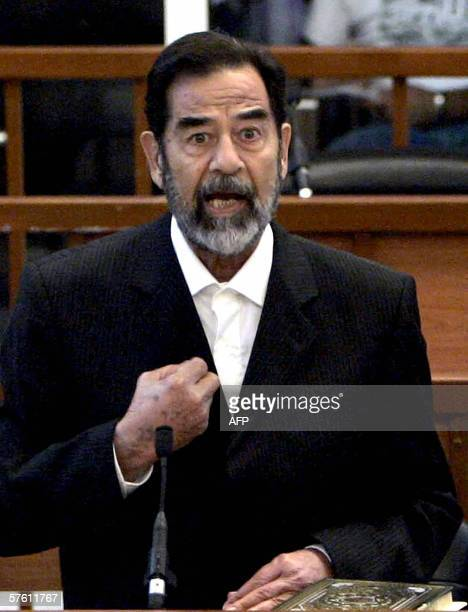 Former Iraqi President Saddam Hussein testifies after the Head Judge Raouf Abdel Rahman reads to him his charges during his trial held in Baghdad's...