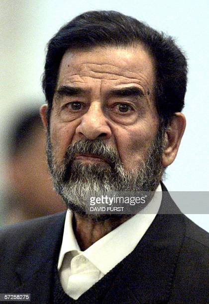 Former Iraqi President Saddam Hussien grimaces during crossexamination in his trial held in Baghdad's heavily fortified Green Zone 05 April 2006...