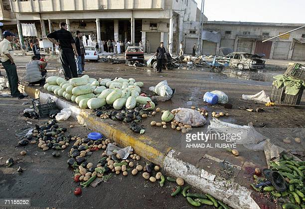 Fruits and vegetables are scattered at the site where a car bomb exploded in a market place in Baghdad's Kazemiya district 08 June 2006 Seven people...