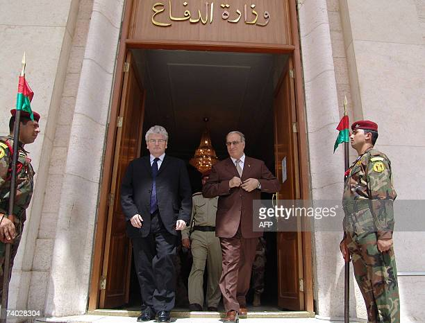 Iraqi Defence Minister Abdel Qader alObeidi walks with his British counterpart Des Browne following their meeting in Baghdad 30 April 2007 Browne met...
