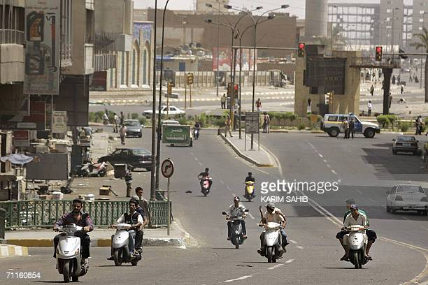 Iraqi motorists drive in an empty street few minutes before the start of a curfew in central Baghdad 09 June 2006 after the wartorn capital was...