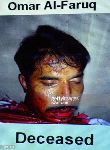 Iraqi National Security Advisor Muwaffaq alRubaie shows the corpse of terrorist Omar alFaruq who was killed by the British soldiers last week in the...