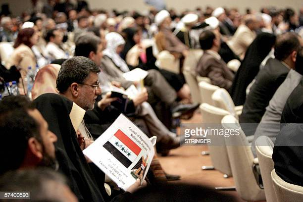 Iraqi Parliament members listen to proceedings during a parliament session held under tight security in Baghdad's heavily fortified Green Zone 22...