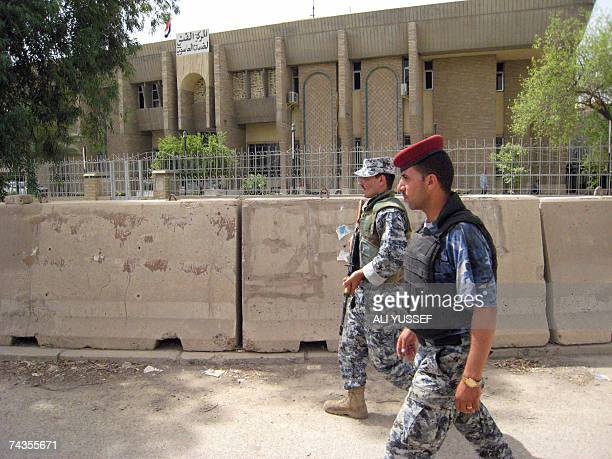 Iraqi police commandos patrol around the finance ministry building in Baghdad where five British contractors were kidnapped yesterday in broad...