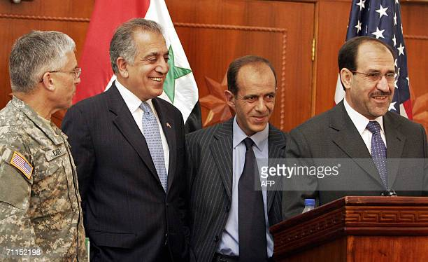 Iraqi Prime Minister Nuri alMaliki flanked by US Ambassador to Iraq Zalmay Khalilzad top US commander in Iraq Gen George Casey and an unidentified...