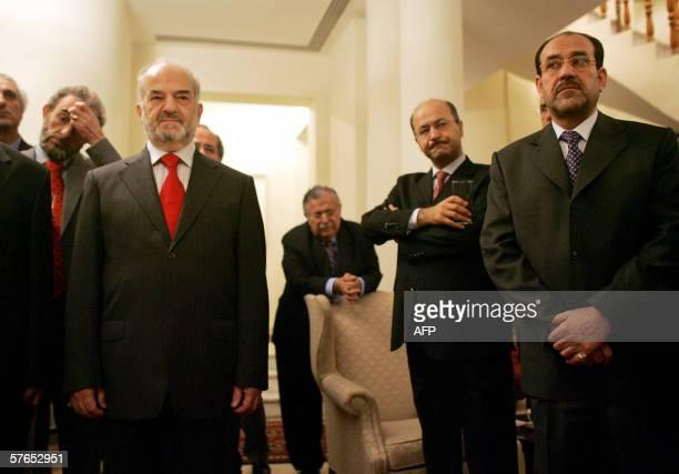 Iraqi Prime Minister-designate Nouri al-Maliki and Iraqi outgoing Prime Minister Ibrahim al-Jaafari listen to US Ambassador to Iraq Zalmay Khalilzad...