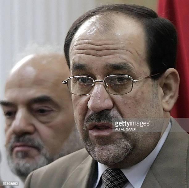 Iraqi Shiite politician Jawad alMaliki speaks during a press conference as embattled Iraqi Prime Minister Ibrahim Jaafari looks on in Baghdad 22...