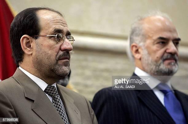 Iraqi Shiite politician Jawad alMaliki stands next to embattled Iraqi Prime Minister Ibrahim Jaafari during a press conference in Baghdad 22 April...