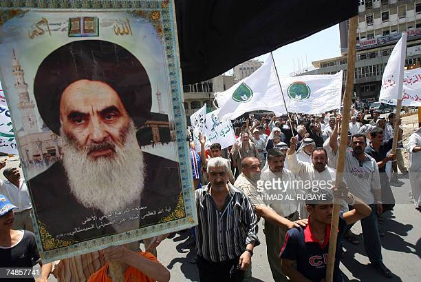 Iraqi Shiites carry a poster of Grand Ayatollah Ali al-Sistani as they rally outside the al-Kholani mosque in central Baghdad, 22 June 2007, to...