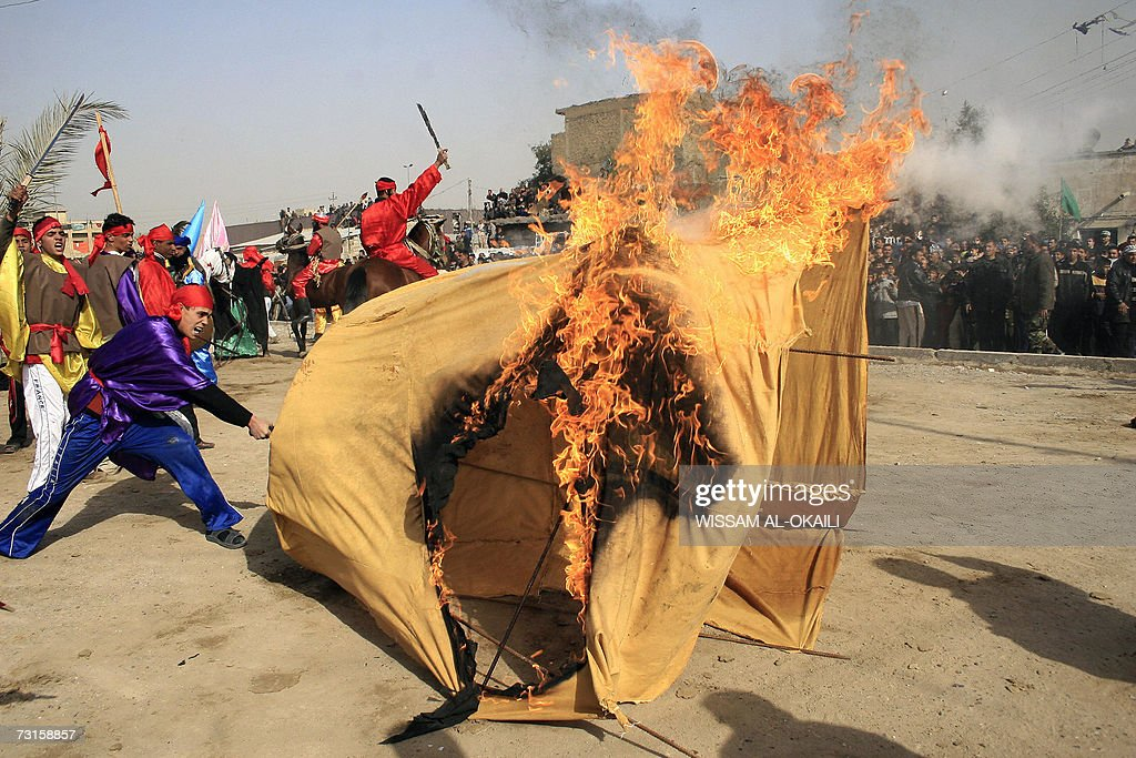 Iraqi Shiites set a tent on fire as they perform a reproduction play of the battle & Iraqi Shiites set a tent on fire as they... Pictures | Getty Images